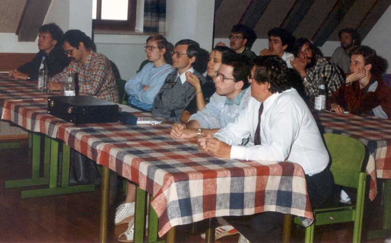 The audience at the end of the 1990 IMC, first table from left to right Ralf Koschack, André Knöfel, Rainer Arlt, Dieter Heinlein, Gabriele Marxer, ??, Martin Mayer. Second table left to right, Thomas Rattei, Janko Richter, Ulrich Sperberg and Roland Winkler (credit Casper ter Kuile).
