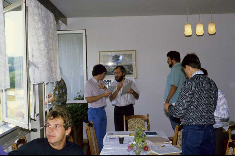 From l.to r. Stefan Ströbele (front), Malcolm Currie, Jürgen Rendtel, Mark Vints and Petr Pravec talking to Marc Gyssens (credit Axel Haas).