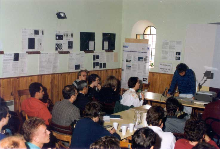 Valentin Grigore presenting 'First meteor camp in Romania', at the left corner of the photo we recognize David Asher and Krisztián Sárneczky in the public (credit Casper ter Kuile).