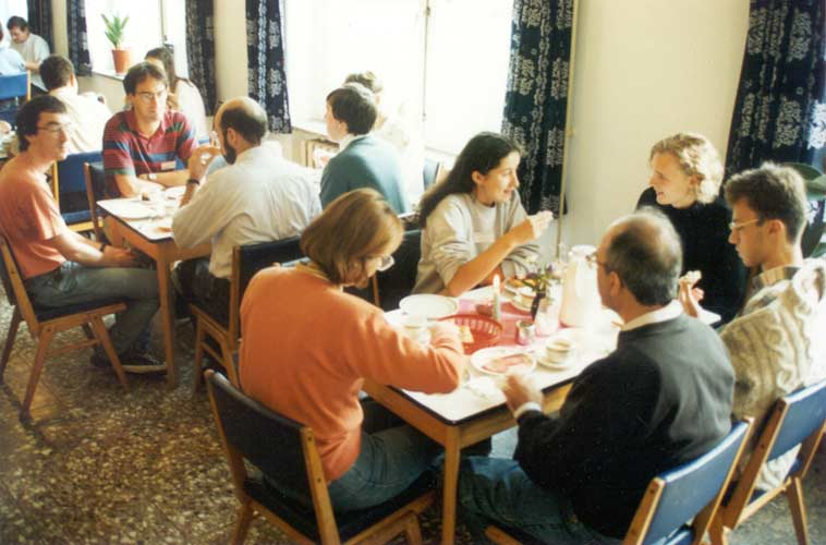 Lunch at the 1995 IMC, table in front Isabel Vinuesa Vivanco, Dragana Okolić, Manuel Ruiz Solano, Mare Igličar and Manuel Solano Vinuesa. Second table Tom Roelandts, Marc de Lignie, Carl Johannink (back), Malcolm Currie (back) and someone hidden (credit Casper ter Kuile).