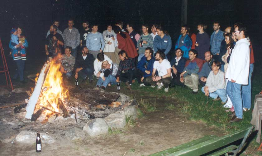 All together around the campfire, at left Gaby Koschny with Richard Koschny on her arm (credit Casper ter Kuile).