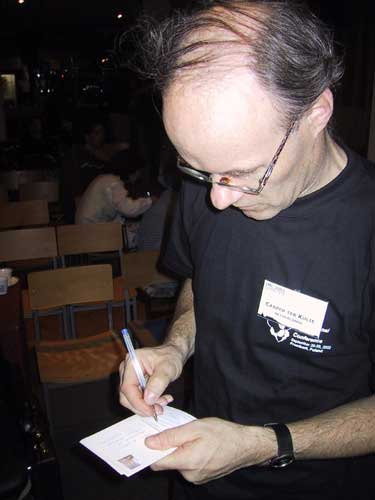 At each IMC postcards are being sent to friends unable to attend, here Casper ter Kuile writes some postcards (credit Casper ter Kuile).