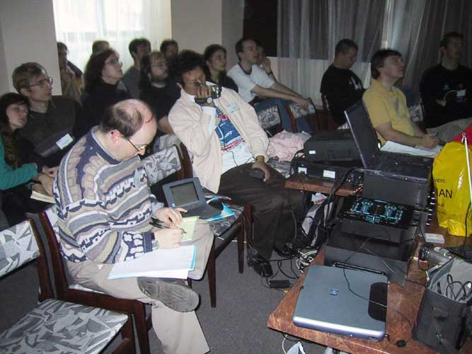The audience in the conference room, with in front Marc Gyssens and Jin Zhu (filming) (credit Casper ter Kuile).