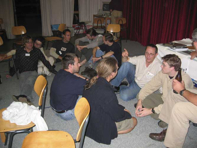 In the late evening, talks take place at a lower level. From l.to r. Felix Bettonvil, Dragana Okolic, ??, Javor Kac, Luc Bastiaens, Jan Verbert, Jean-Marc Wislez, Marc Neijts and Steven Van Impe (credit Casper ter Kuile).