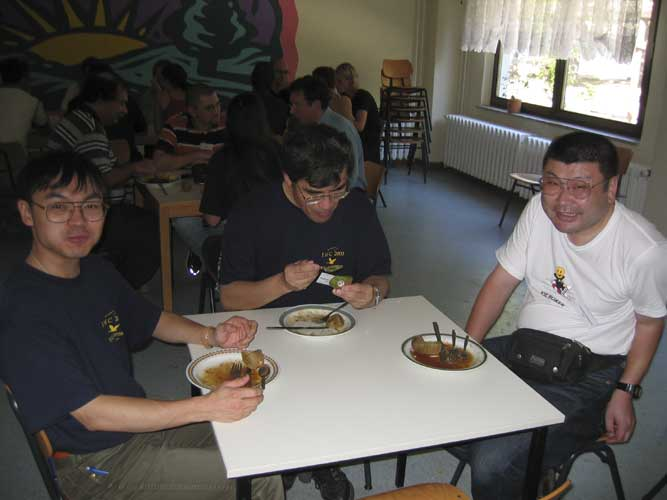 Lunch at the 2003 IMC from l.to r. ??, Nagatoshi Nogami and Yasuhiro Tonomura (credit Casper ter Kuile).
