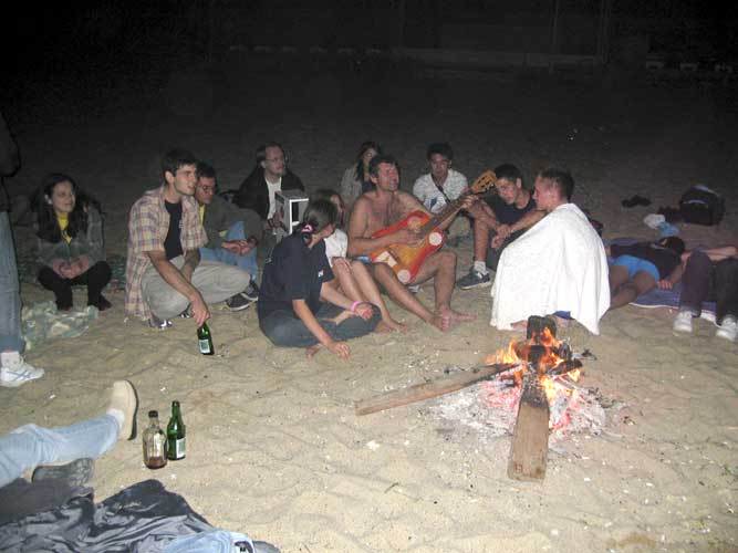 Campfire on the beach with Valentin Velkov playing guitar (credit Casper ter Kuile).