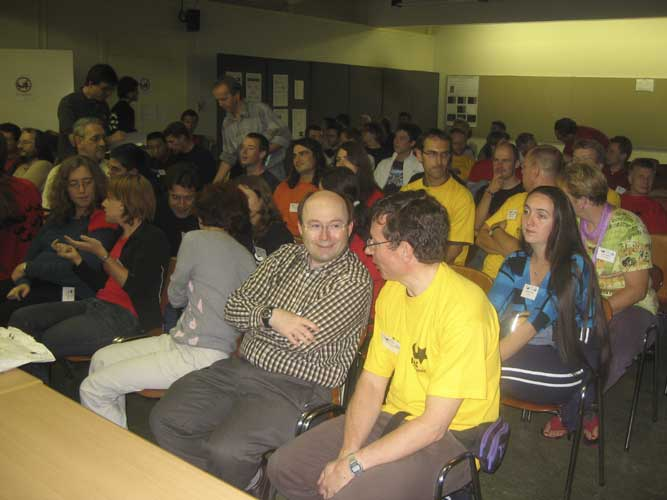 The audience at the opening of the IMC with in front Marc Gyssens and Paul Roggemans (credit Casper ter Kuile).