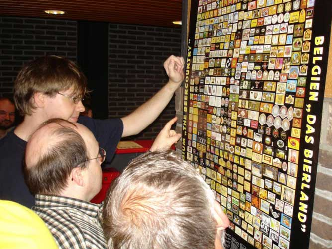 Steven Van Impe and Marc Gyssens admiring Belgian beer labels (credit Jos Nijland).