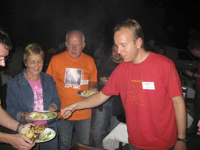 Joost Hartman serving at the barbecue (credit Casper ter Kuile).