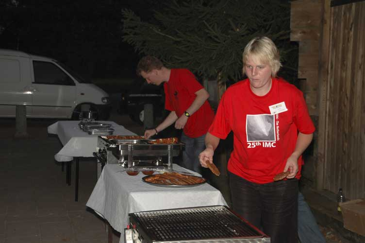Roy Keeris and Emma Versteegh working at the barbecue (credit Urijan Poerink).