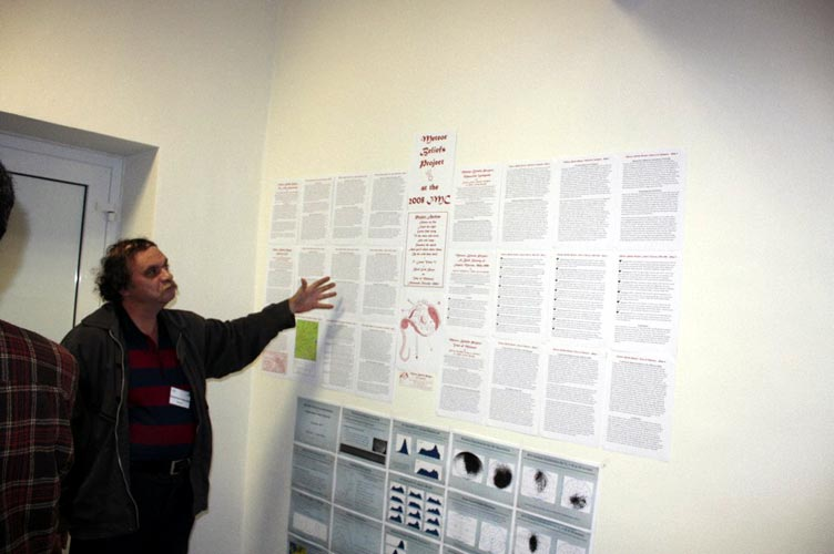 During the poster session: Andrei Dorian Gheorghe commenting his poster (credit Bogdan Cristian Călin).