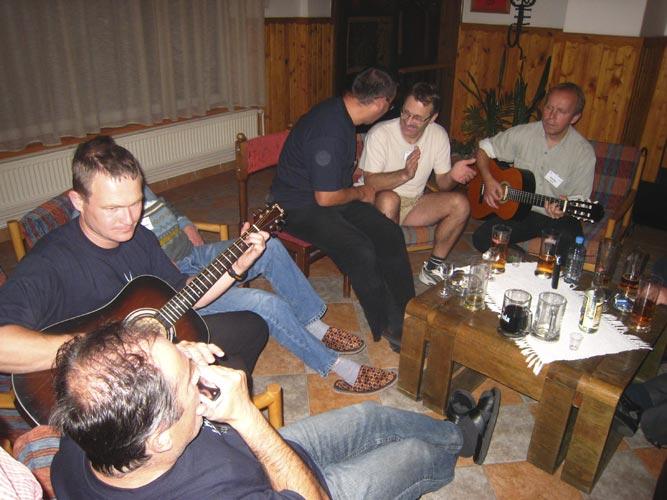 Friday evening free time in the bar: music became a very important aspect at IMC evenings. Jan Masiar (harmonica), Stanislav Kaniansky (guitar), Peter Zimnikoval, Jaroslav Gerbos (looking away), Štefan Gajdoš and Pavol Zigo (guitar) (credit Casper ter Kuile).