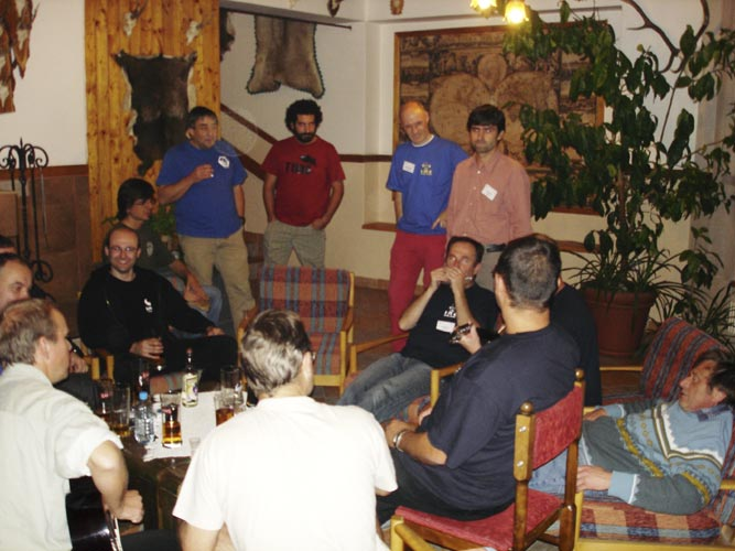 Friday evening free time in the bar: Mirosław Krasnowski, Przemyslaw Zoladek (hidden), Pavol Zigo (back), Mariusz Wiśniewski, Antonio Martinez, François Colas, Štefan Gajdoš (back), Gregoris Maravelias, Casper ter Kuile, Jan Masiar (harmonica), Juraj Toth, Jaroslav Gerbos, Stanislav Kaniansky (hidden with guitar) and Peter Zimnikoval (credit Jos Nijland).