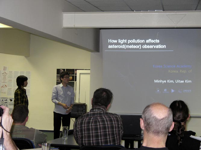 Minhye Kim and Uitae Kim with 'How light pollution affect asteroid (meteor) observation' (credit Xiang Zhan).