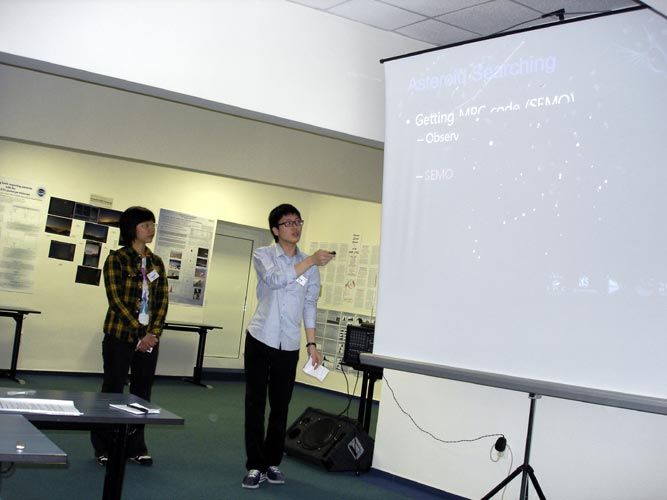 Minhye Kim and Uitae Kim with 'How light pollution affect asteroid (meteor) observation' (credit Jos Nijland).