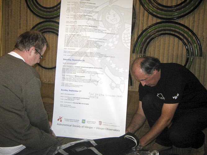 Željko Andreić (left) and Korado Korlević (right) installing the IMC-reception desk (credit Željko Andreić).