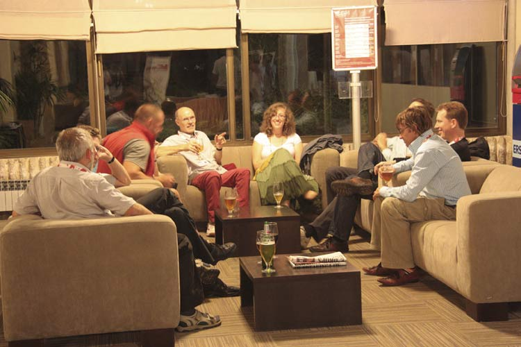 Informal talks in the large hotel foyer, from l.to r. Jürgen Rendtel, Sirko Molau, Arnold Tukkers (moving), Casper ter Kuile, Nastassia Smeets, someone hidden, Roy Keeris and Felix Bettonvil (credit Korado Korlević).