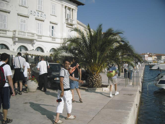 Walk through Poreč, the harbour of the city, Mihail Robescu looking to the camera (credit Mihail Robescu).