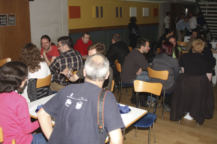 Friday noon lunch in the Market Place Theatre. At left we see Luc Bastiaens and Frans Lowiessen, right from the center Javor Kac (credit Bernd Brinkmann).