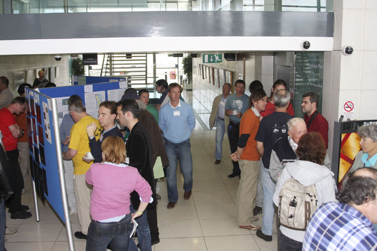 Poster session with the authors explaining their paper (credit Bernd Brinkmann).