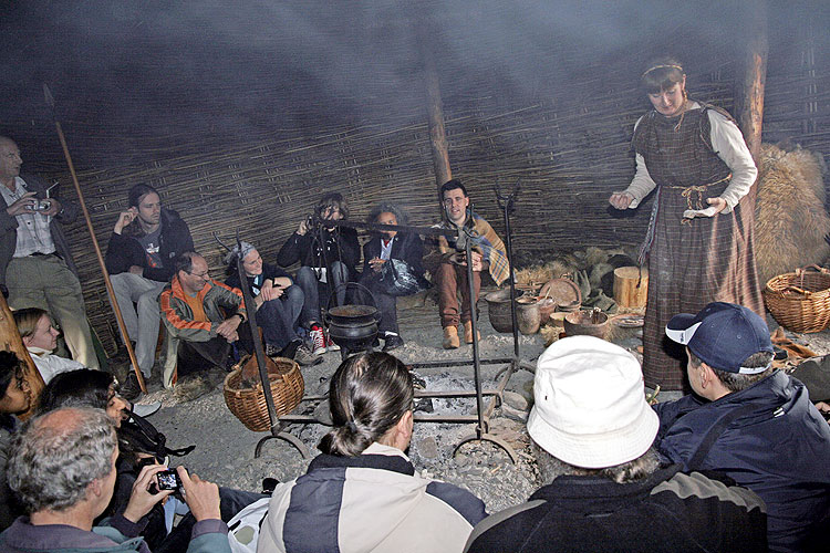 Saturday afternoon visit to Navan Centre: actors perform the daily life of the Navan tribes, cosy around the fire going from right in front ??, Valentin Grigore (white head), Antonio Martinez Picar, Tony Markham (with camera), Naslim Neelamkodan, Kamalam Vanninathan, Anna Kartashova, Terry Moseley, Luc Bastiaens, Christian Steyaert, Megan Argo, Geert Barentsen, Eliška Anna Kubičková and two 'Navans' (credit Thomas Grau).