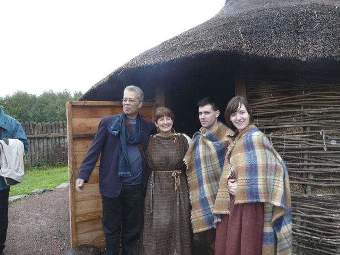 Saturday afternoon visit to Navan Centre, Rishi Shah posing with our Navan hosts before their hut (credit Paul Roggemans).