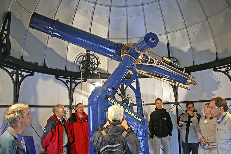 Saturday afternoon visit to Armagh observatory: the large refractor, with from l.to r. Tony Markham, Richard White, Bill Ward, ?? (back), Luc Bastiaens, Antonio Martinez Picar, Malcolm Currie and Apostolos Christou (credit Thomas Grau).