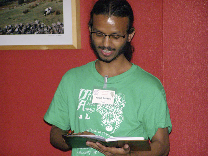 Astro-Poetry show: Suresh Bhattarai with a poem (credit Adriana Nicolae).