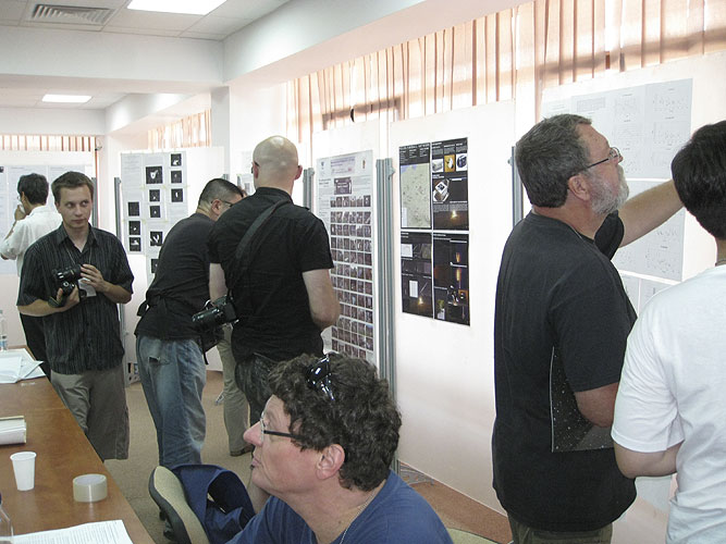 The poster session with from left to right Krzysztof Polakowski, Detlef Koschny and Jean-Louis Rault (credit Valentin Grigore).