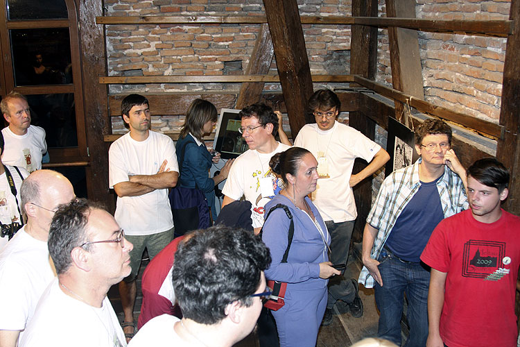 During the walk in the historic city: explanation in the old Council tower of Sibiu. From left to right: Pavol Zigo, Casper ter Kuile (half hidden), Miroslav Krasnowski, Juarj Toth, Lidia Egorova (looking away), Przemyslaw Zoladek, Paul Roggemans, Adriana Nicolae, Antonio Martinez, Detlef Koschny and the tour guide (credit Bernd Brinkmann).