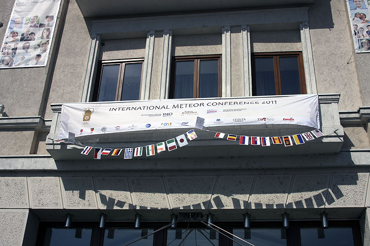 The IMC banner above the entrance of the Hotel Continental forum (credit Bernd Brinkmann).