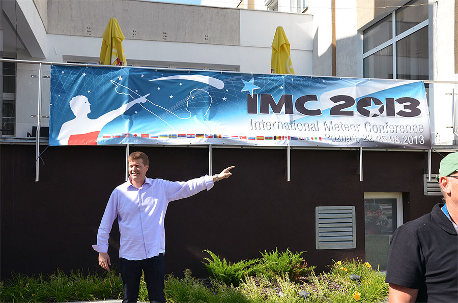 The 2013 IMC banner at the IOR Hotel with Mike Hankley. (credit Axel Haas).