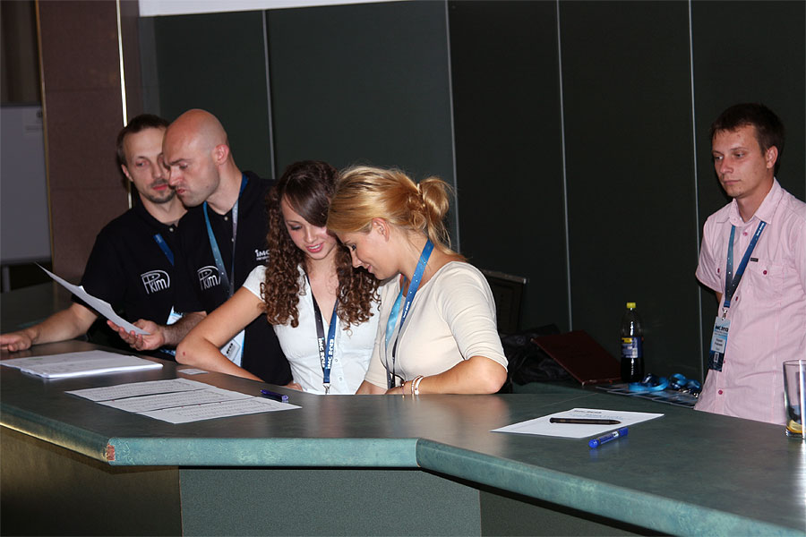 The 2013 IMC registration desk with some of the LOC members. From left to right: Karol Fietkiewicz, Mariusz Wiśniewski, Weronica Piechota, Ania Krasnowska and Krzysztof Polakowski. (credit Bernd Klemt).