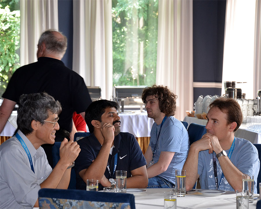 Friday Lunch time: From left to right we see Nagatoshi Nogami, Pete Gural (back), Aswin Sekhar, Janez Kos and Jérémie Vaubaillon. (credit Axel Haas).