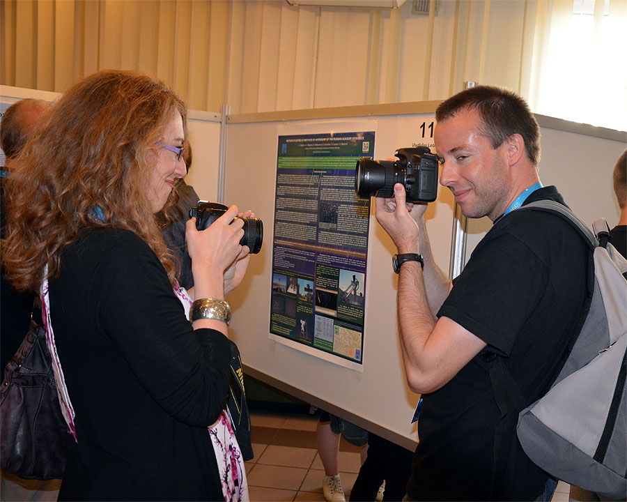 During the poster session: IMC photographers at work, Nastassia Smeets and Javor Kac. (credit Axel Haas).