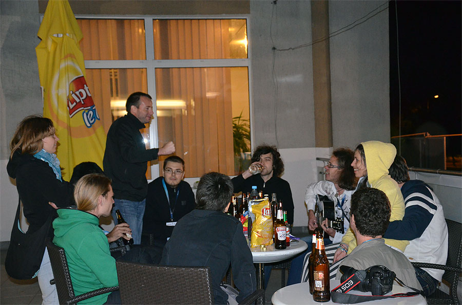 Friday evening socializing: from left to right Maruška Mole, Francisco Ocaña (hidden), Klemen Čotar, Javor Kac (standing), Mitja Govedič, Ana Žegarac (back), Janez Kos, Matic Smrekar (guitar), Nina Smrekar, Jure Atanackov (hidden) and Detlef Koschny (back). (credit Axel Haas).