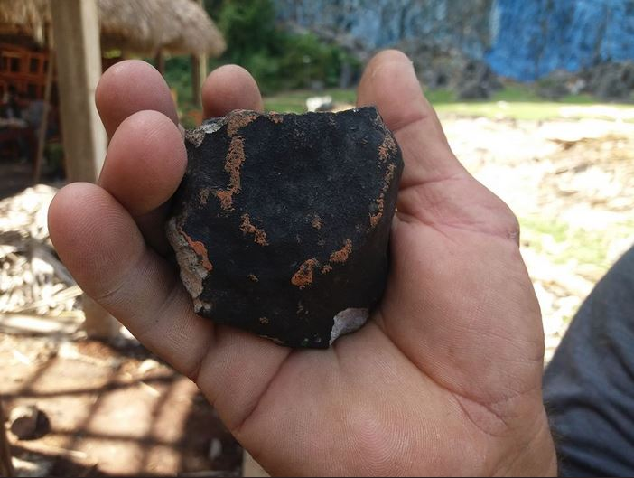 Fragment of meteorite that fell over Western Cuba on February 1st. Credit: Fatima RIVERO/TelePinar/AFP